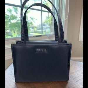 Black fabric evening bag.